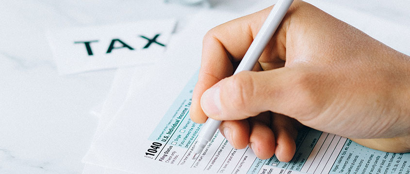 Person filling out 1040 form
